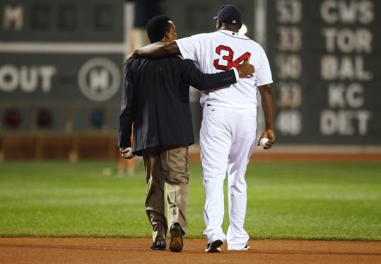"""Former Boston Red Sox pitcher Pedro Martinez (L) and Red Sox player David Ortiz walk together across the field after being introduced as members of the """"All-Time Fenway Park Team"""" before the start of American League MLB baseball action between the Boston Red Sox and Tampa Bay Rays at Fenway Park in Boston, Massachusetts September 26, 2012. The All-Fenway Team comprises the greatest Red Sox players in Fenway Park history as determined by fans voting, historians, staff, and the club's…"""