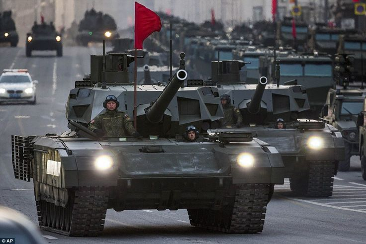 New Russian military vehicles including the new Russian T-14 Armata tank, foreground, make...