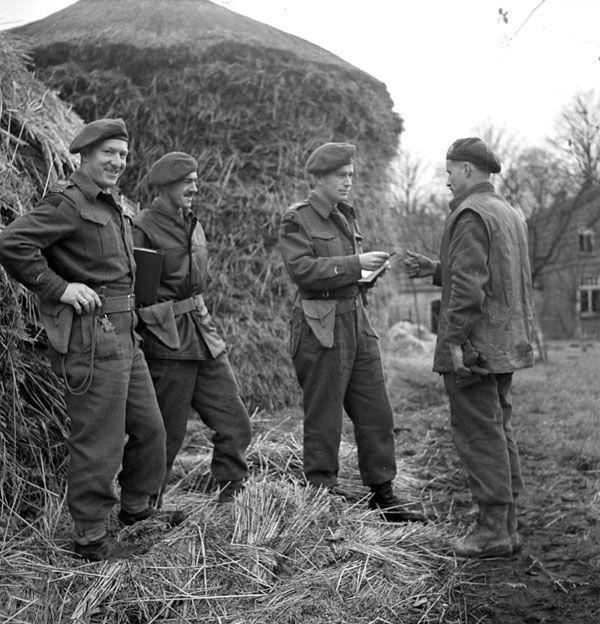 "Title: Presentation of the Military Medal to Company Sergeant-Major Jim Smith of ""D"" Company, The South Saskatchewan Regiment, Mook, Netherlands, 30 November 1944. Photographer: Dean, Michael M. Location: Mook, Netherlands,: Description: (L-R): Major G.B. Buchanan, Major E.W. Thomas. Subject: Buchanan.@Thomas.@Smith, Jim.@Mil. - Units - South Saskatchewan Regiment - 1944/11/30.@Netherlands - Mook.@Army. Date: November 30, 1944. MIKAN Number: 3224077 Item Number: 773"