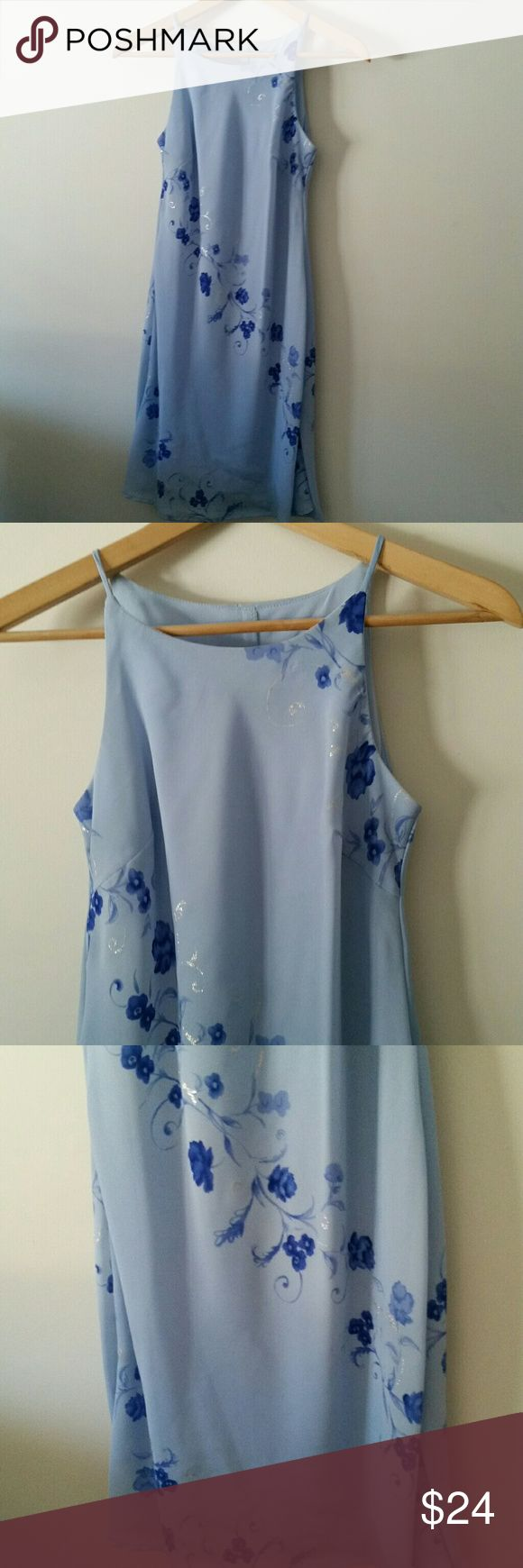 Light Blue Floral Dress Size 3/4 EUC Pretty light blue floral dress, with sparkly silver design. Fully lined. Size 3/4. Steppin Out brand. Excellent condition! Steppin' Out Dresses