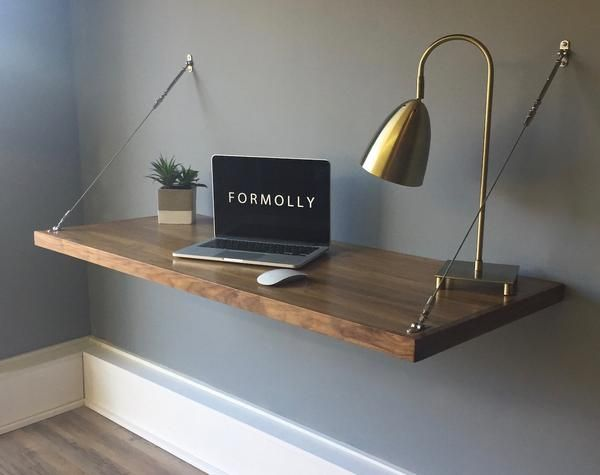 Simplify your workspace with the wall mounted hanging desk by Formolly. The  unique stainless steel