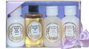 Lavender Travel Pack By Warratina Lavender Farm. Hand & Body, Massage Oil, Shampoo, Conditioner. Attractive gift box with satin ribbon containing essential bathroom products for the traveller.