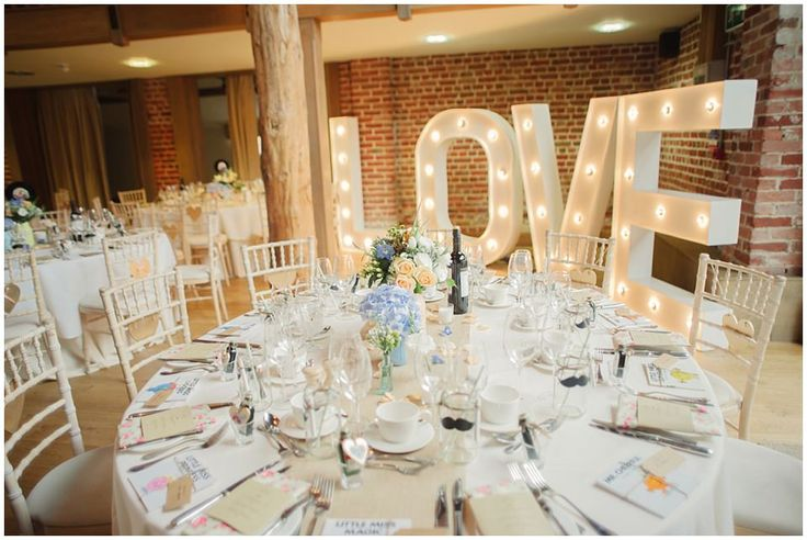 Giant Light Up LOVE letters from Vowed and Amazed - Image by Kerrie Mitchell - Pastel Wedding With Shabby Chic Styling At Gaynes Park With Bride In Lace Fishtail Sarah Janks Gown With Groom In Powder Blue Bowtie From Mrs Bowtie And Images By Kerrie Mitchell
