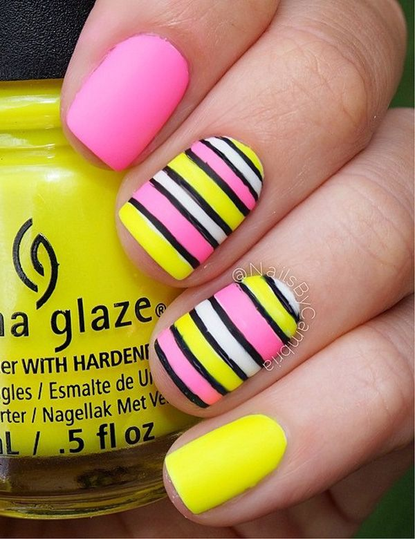 Yellow and pink themed spring nail art design. The bright and bold colors definitely speak of spring with the help of the thick black lines you can make a striped alternate color combination.