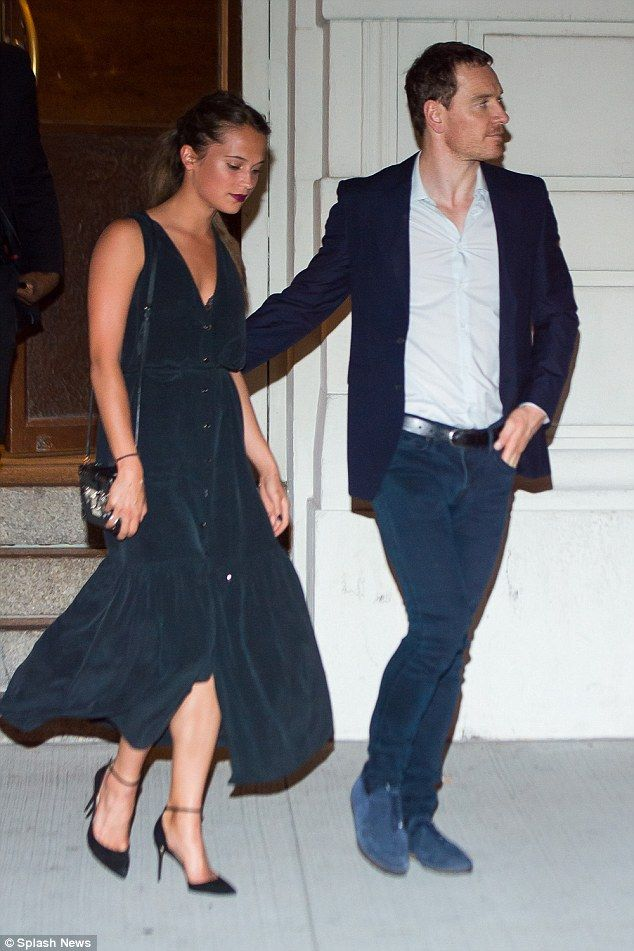 Chic as ever: Alicia looked the picture of elegance in the button-down number, which boast...