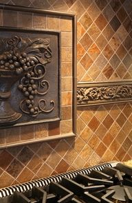 Tile backsplash with molding and sculpted picture