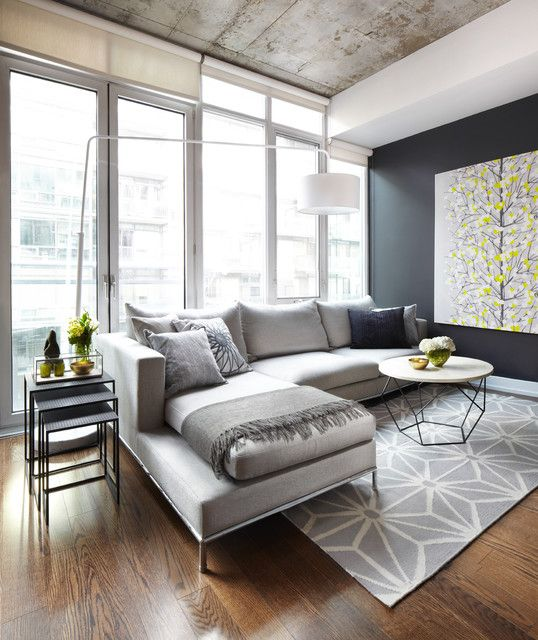 Grey and Yellow Living Room Design with modern sectional - I really like how they incorporated the throw blanket  My next couch. I love the neutral gray. You can change up the accent pillows as the season changes. Throw some color in there!