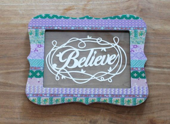 "Papercut art quote in an unique colorful frame; ""Believe""."