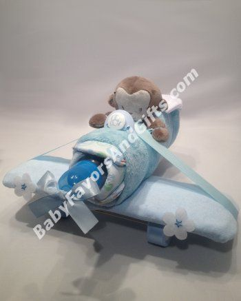 Airplane Diaper Cake is built from  14 Diapers size 1-2 (up to 15lb)  Hooded Towel  Security Blanket  Baby Bottle  Pacifier  7 Washcloths