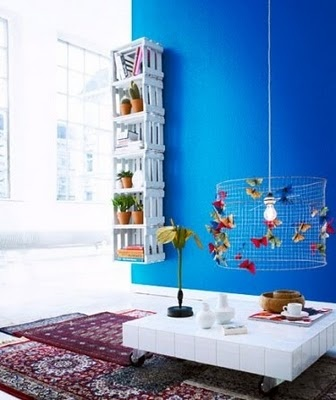 hmmm....are you bold enough??  DIY this fixture with some chicken wire and a light kit, pin pictures and/or kid's artwork on it...or notes....above dining/school table?