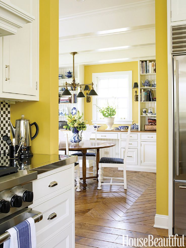 55 Inspiring Ideas to Update Your Kitchen. Yellow. Kitchen designer Mick de Giulio created a homey kitchen with a retro feel in this Chicago home using yellow paint on the walls. The walnut floor, hand-scraped to give it even more character, changes to a chevron pattern in the adjoining breakfast room. The yellow paint, Benjamin Moore's HC10, unifies both rooms.