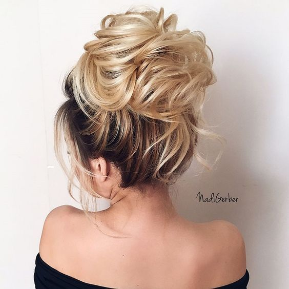 Beautiful high bun hairstyle for romantic brides - Bridal hairstyle. Get inspired by this low updo bridal hair gorgeous stylesbridal high bun