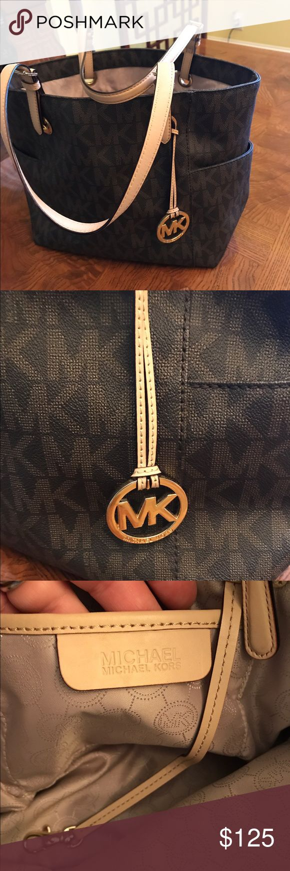 Michael Kors Jetset tote Excellent condition brown jetset signature tote by Michael Kors. Barely used but has one very small light stain on bottom inside. Lots of compartments and middle zip pocket. Michael Kors Bags Totes
