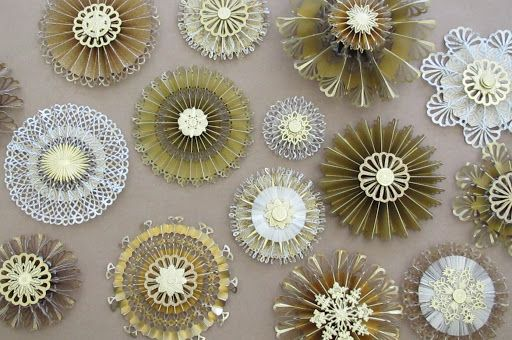 craft tutorial: Paper Medallions  from the The Crafts Dept. of Martha Stewart ... use gorgeous gold and white and translucent papers to create these medallions ... tree decorations  or hang in windows ... scoring and edge punching ... folding and hot gluing ... gorgeous!!