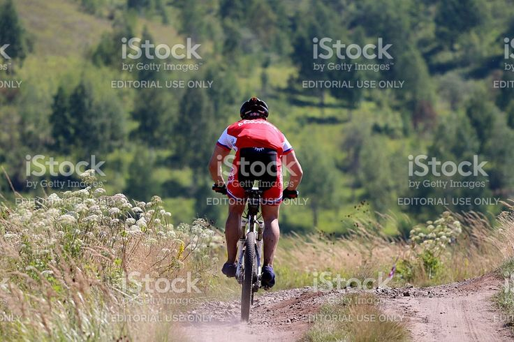 Upper Ufaley, Russia - January 19, 2013: Racer mountain bike ride from the mountain during cross-country marathon 'Big stone 2014'