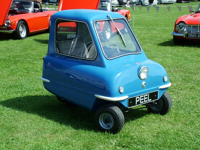 "The Peel p50. Built on the Isle of Man in 1963 it is the record holding smallest car in the world. The only thing better than looking at this car is watching all 6'5"" of Jeremy Clarckson drive it.   http://www.youtube.com/watch?v=dJfSS0ZXYdo"