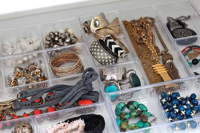 Bracelets and necklaces are now separated into shallow, acrylic trays with compartments