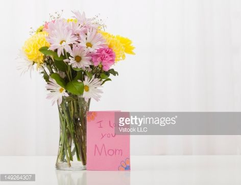 Stock Photo : Bouquet in vase with greeting card for Mother's Day