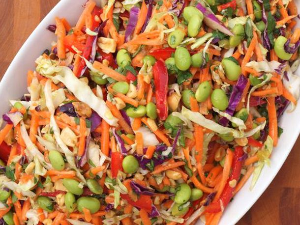 Dressing: honey, oil, rice vinegar, soy sauce, toasted sesame oil, peanut butter, salt, Sriracha sauce, minced fresh ginger, garlic minced   Slaw: shredded green or white cabbage, carrots, peeled, red bell pepper, edamame, scallions, peanuts, cilantro