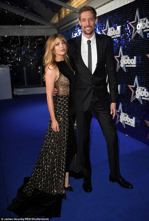Cute couple: Abbey Clancy proved she'd snapped straight back into shape as she donned a figure flaunting jumpsuit at the Global Awards with husband Peter Crouch on Thursday