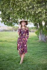"This floral print midi dress in wine is the perfect length and so comfy! - Long sleeve - Cinched waistline - Hidden pockets Model is 5'7"" wearing a small. Runs true to size. Small (0-4), Medium (4-8),"