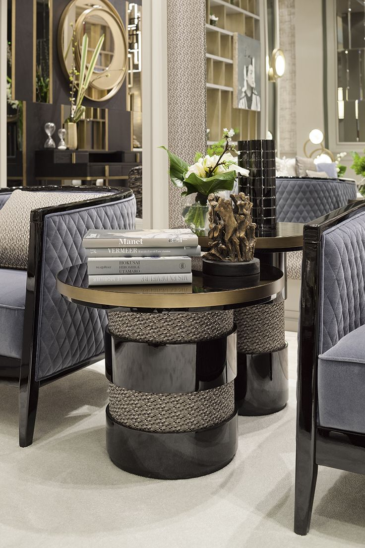 Eros side tables featuring a fabric and black oak base. The precise selection and marrying together of products and materials create unique textures and moods to appeal to all tastes and individual requirements.