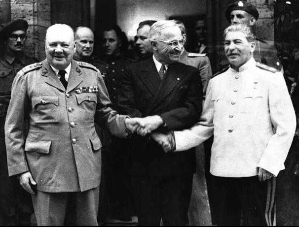 Winston Churchill, Harry Truman, and Joseph Stalin shake hands in Potsdam, Germany, on July 23, 1945. The triple handshake capped off a series of discussions on how to handle postwar Europe, after the official surrender of Nazi Germany on May 8 of that year.