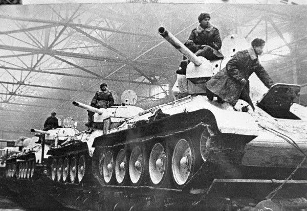 Newly built T-34 tanks being prepared for rail transport to Eastern Europe, Uralmash production facility, Sverdlovsk, Russia, 1 Feb 1942