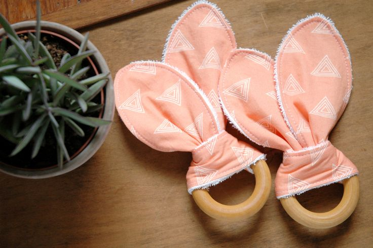 Peach Wood Teether, Pastel Apricot, Modern Triangles, Baby Girl Teething Toy, Natural Wood, Bunny Ears, Terry Cloth, Shower Gift, by thebirdandelephant on Etsy https://www.etsy.com/listing/238819213/peach-wood-teether-pastel-apricot-modern