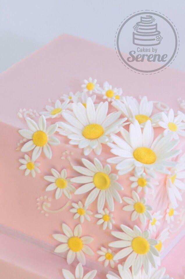 Sweet pink and daisies wedding cake