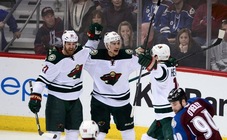 Apr 30, 2014; Denver, CO, USA; Minnesota Wild right wing Nino Niederreiter (22) is congratulated following his game winning overtime period goal by center Kyle Brodziak (21) and left wing Dany Heatley (15) against the Colorado Avalanche in game seven of the first round of the 2014 Stanley Cup Playoffs at Pepsi Center. Mandatory Credit: Ron Chenoy-USA TODAY Sports