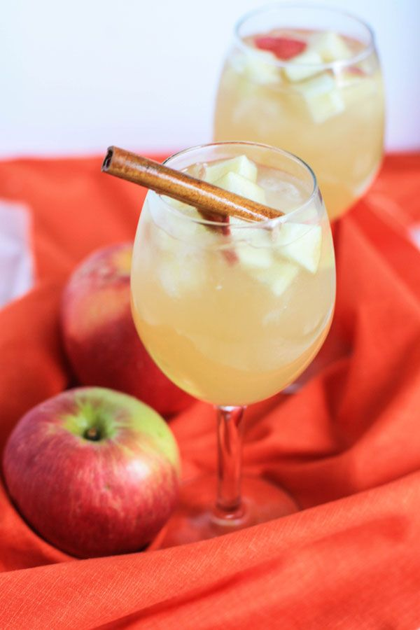 Apple Cider Sangria - Ingredients  1 bottle Moscato wine (semi-sweet white wine)  1 cup light rum  1 ½ cups apple cider  1 cup ginger ale  apple slices for serving  ice