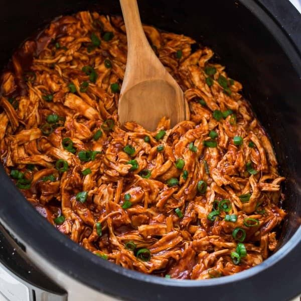 BEST EVER Crock Pot BBQ Chicken! Easy and SO GOOD! Healthy slow cooker recipe that works for chicken breasts, legs, thighs, or drumsticks. Better than Sweet Baby Rays! Use this flavorful shredded chicken for BBQ chicken sandwiches, on top of potatoes, or inside shredded chicken tacos. So simple and our whole family loves it!