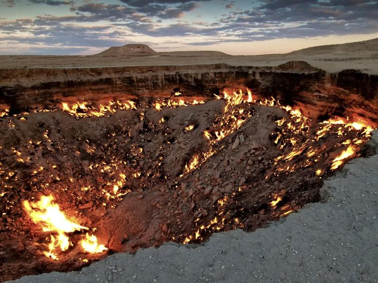 """Darvaza Crater, Derweze, Turkmenistan - aka the """"Door to Hell"""", a crater where fire has been burning since 1971. Picture: Daniel Kreher/Getty Images/ImageBROKER READ MORE:  <a href=""""http://www.escape.com.au/world/asia/heavensent-hotspot-the-door-to-hell-could-be-the-secret-to-a-turkmenistan-tourism-boom/news-story/755baba0571453d8ff068dc2613a0787"""" target=""""_blank"""">The curious case of the Door to Hell</a>"""