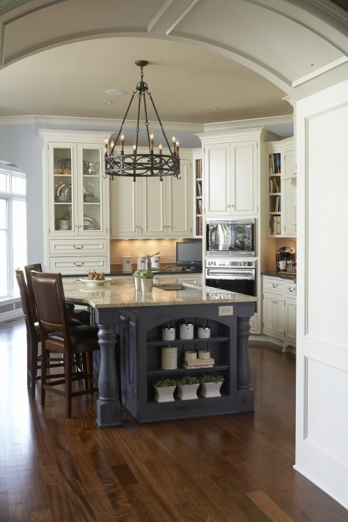 Kitchen With Pale Blue Walls And Slate Blue Island With Creamy White Cabinets