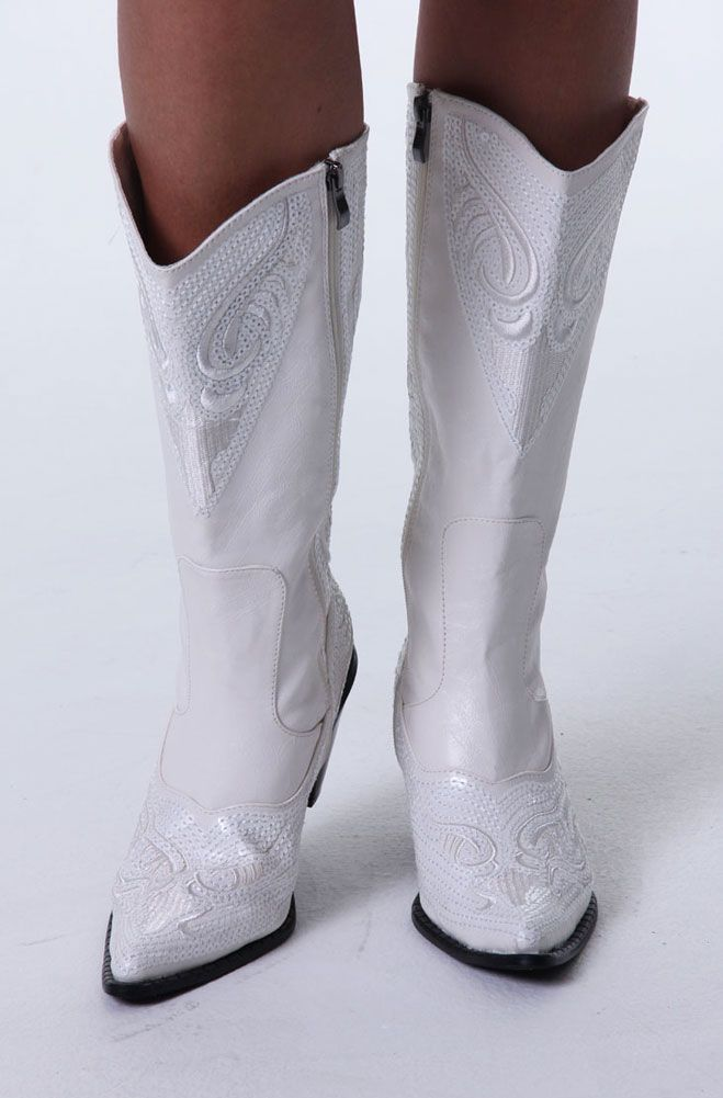 """One of the most comfortable boots. This Western Women boots is very stylish, modern and dressy as well as casual for Boho Chic style to be worn with your Western Wedding Dress, Skirts, Gauchos as well as pants. This beautiful Western Style Boot is in a vibrant white color.It is embroidered and sequined all over. It closes with a zipper. The Shaft ends right below the knee and it has a 3"""" heel. They only come in full sizes. It is manmade. This is one of the most classy and chic Western b..."""