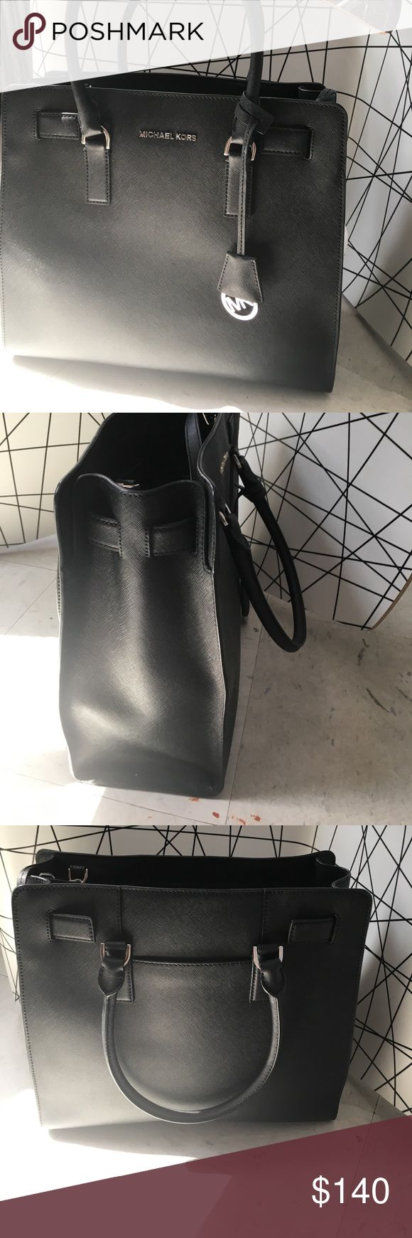 Black Michael Kors Bag Medium size authentic Michael Kors Bag. With Silver hardware. Only worn once or twice KORS Michael Kors Bags Shoulder Bags