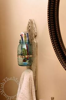 Toothbrush and towel holder out of a mason jar, fence post, and doorknob. Save room on the sink.
