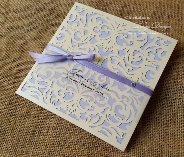 Lavender Ribbon Wedding Invitation With Purple Card Stuck On The Pocketfold.