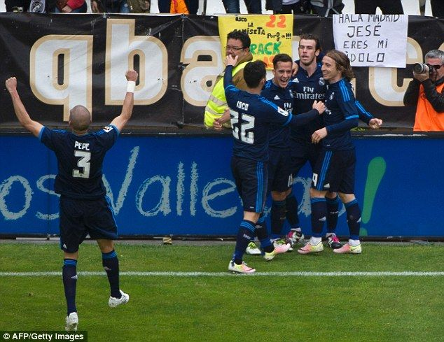 Real Madrid players celebrate after Bale's goal as they came back from two goals down at the Vallecas