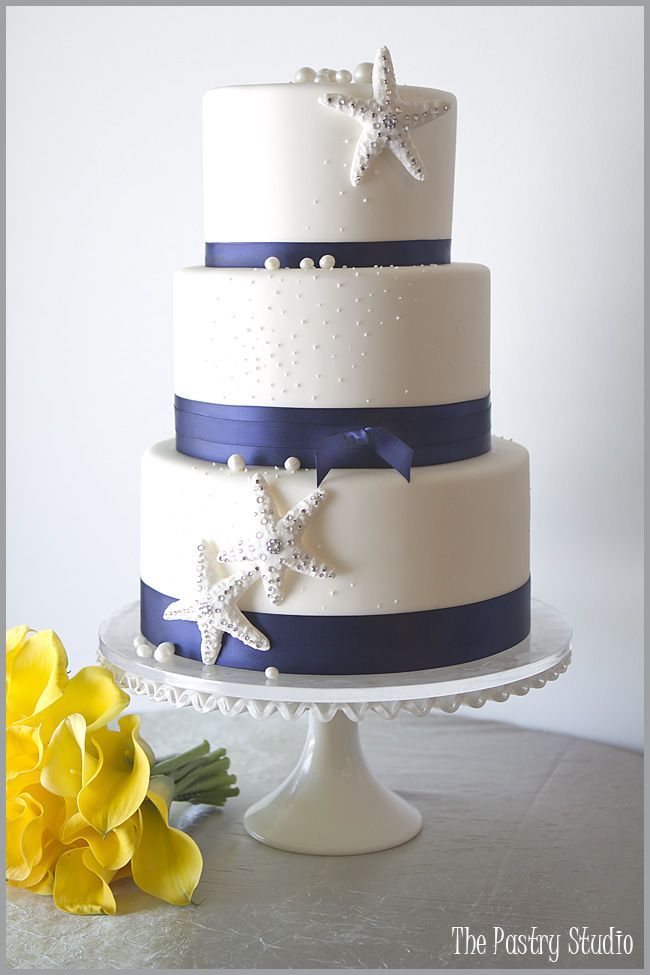 This cake is perfect--it's navy and has the beach theme! Oh--and I LOVE the yellow calla lilies!!!