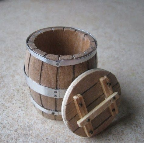 how to: barrel. Wooden napkin wring with grooves carved into it. Round base and lid.