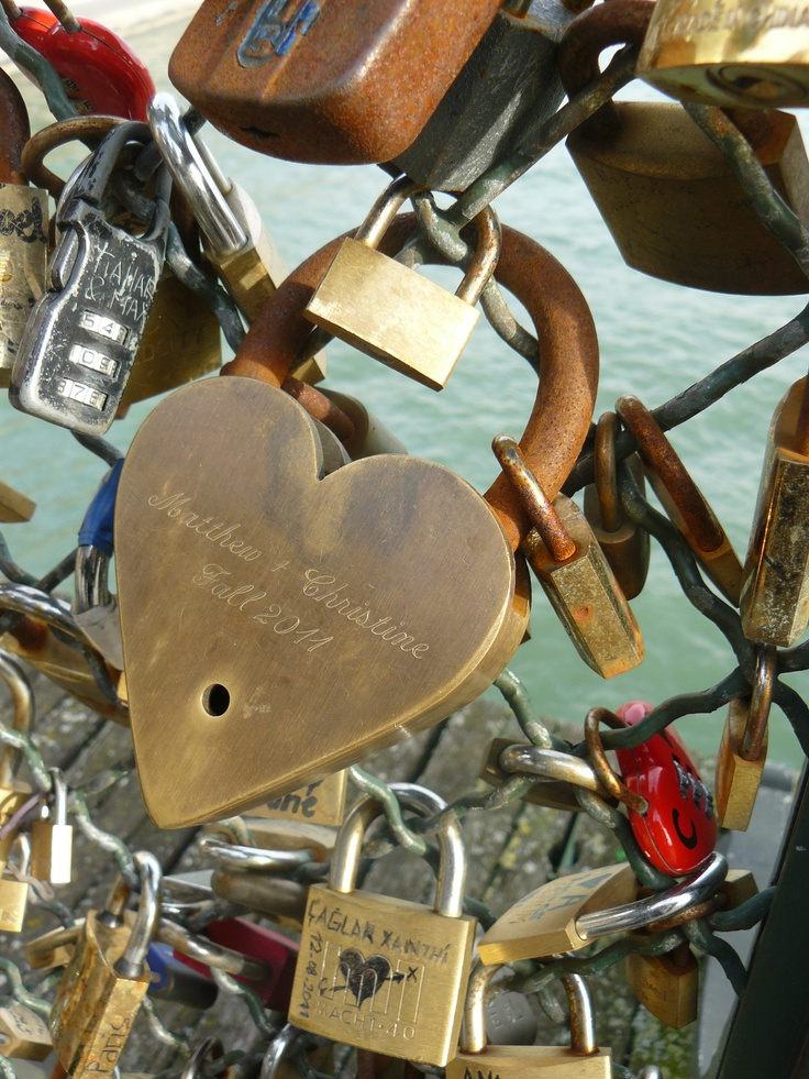 Lock Bridge in Paris. Couples bring a lock and key, make a wish for everlasting love, lock up the lock, and throw the key in the river. How sweet :)