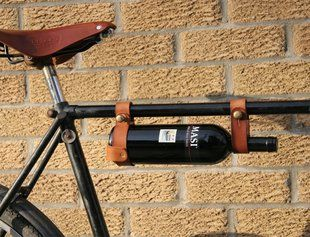 "Leather bicycle wine rack.....""when you absolutely can't leave home without it!"""
