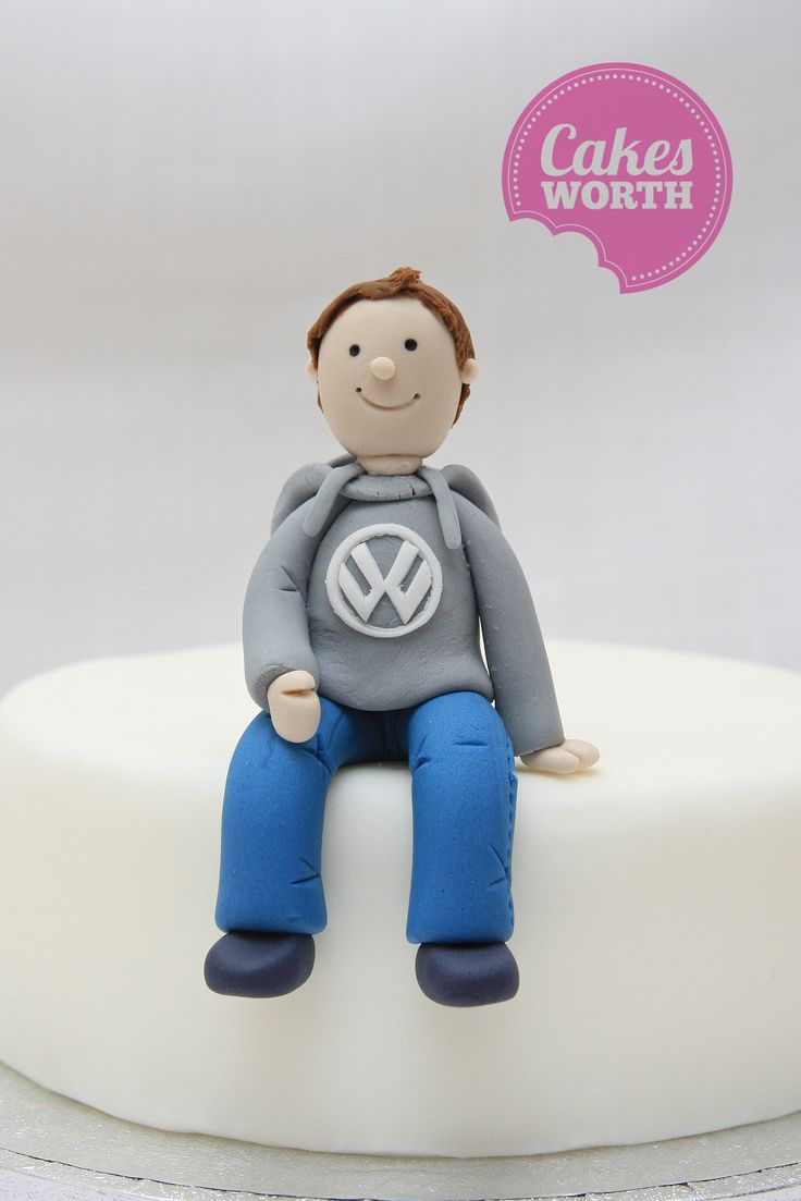Happy little guy wearing a VW hoody ready to sit on the edge of your cake.