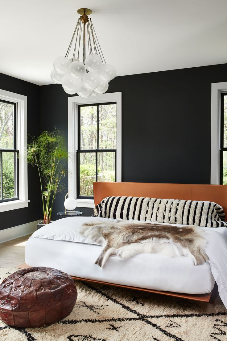 Love that light fitting, the black walls, the headboard, the hide. Delish!