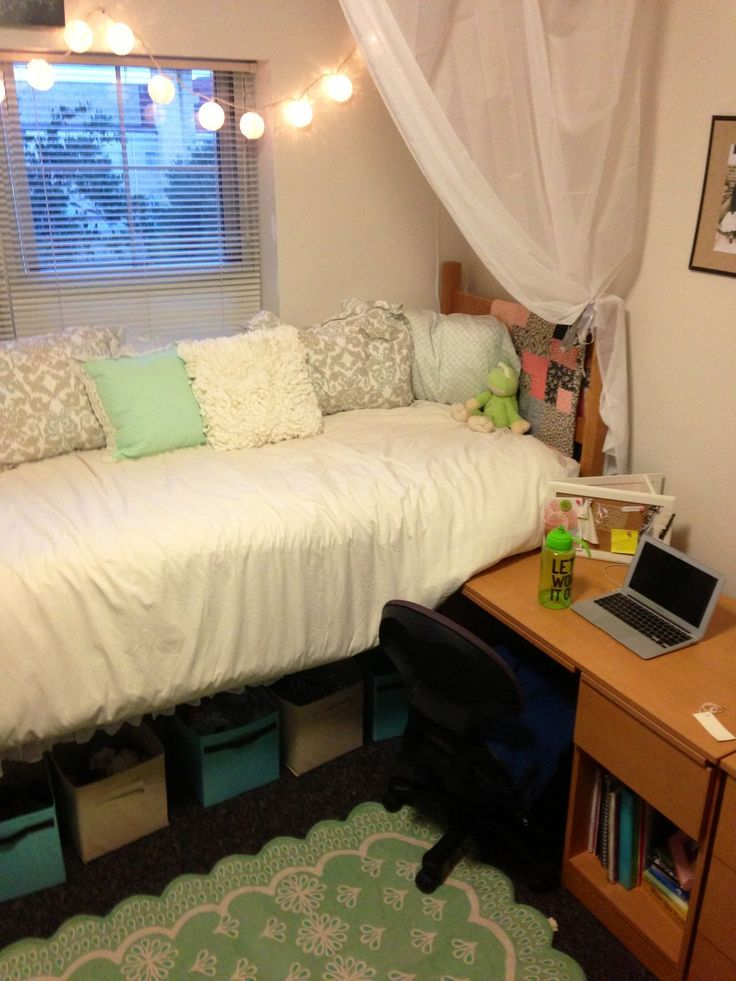 home office, twin bed dressed up like a day bed, lights, sheer curtain, underbed storage