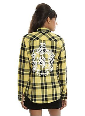 """Robes aren't required attire on trips to Hogsmeade, but you've still got house pride. This black and yellow plaid woven in Hufflepuff colors with the house crest on the back not only shows off your love for your house, but it's also so on trend, muggles wouldn't notice it if you went out in their world.<br><ul><li style=""""LIST-STYLE-POSITION: outside !important; LIST-STYLE-TYPE: disc !important"""">60% cotton; 40% polyester</li><li style=""""LIST-STYLE-POSITION: outside !important…"""