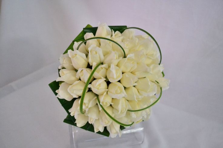 Real touch artificial latex ivory roses with folded cordyline leaves and grass straps. Simple elegance at it's best #justfakeitbouquets #weddingflowers