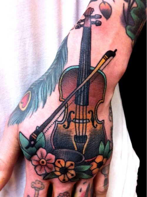 Fantastic Violin Tattoo. Great use of color.